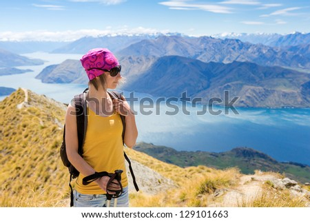 Young woman with backpack has a rest