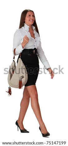 Young woman with bag walking isolated against a white background.
