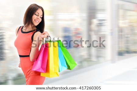 young woman with bags in...