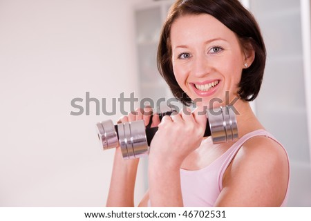 young woman with barbell sport coach