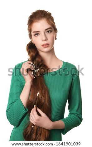 Young woman with beautiful hairdo on white background