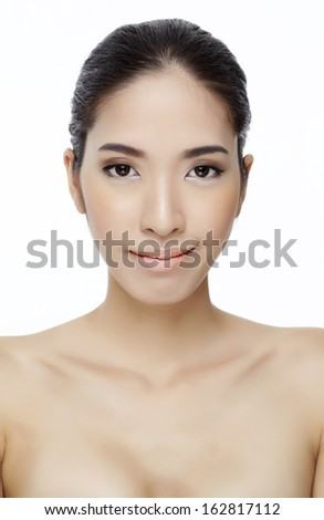 Young woman with beautiful healthy face - isolated on white studio shot