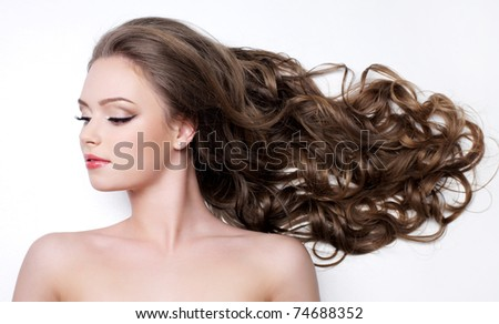 Young woman with beautiful long curly hair - white background