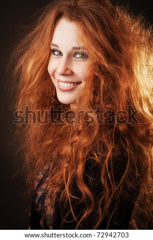 Young woman with beautiful long fluffy hair