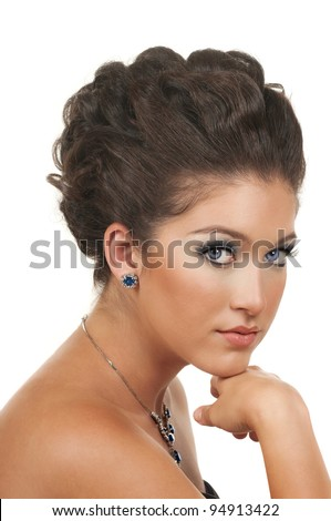 Young woman with beautiful make up, hairdo and sapphire diamond
