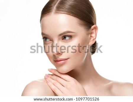 Young woman with beauty skin healthy face close up #1097701526