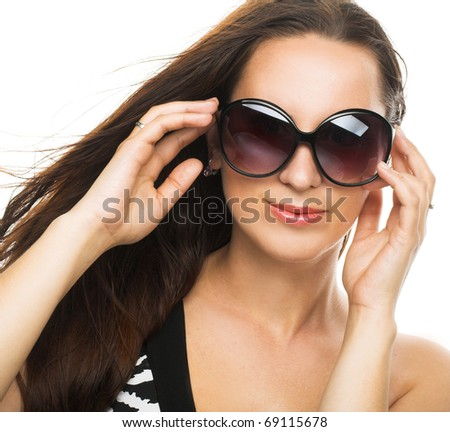 Young woman with big black glasses - stock photo
