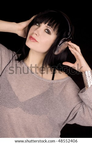 Young woman with black hair listening to music