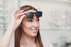 Young Woman with Black punched eyeglasses for vision training. perforated glasses trainer.