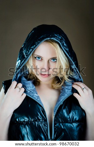 Young woman with blue eyes in a black jacket - stock photo