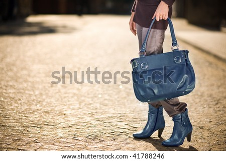 Young woman with blue handbag and shoes