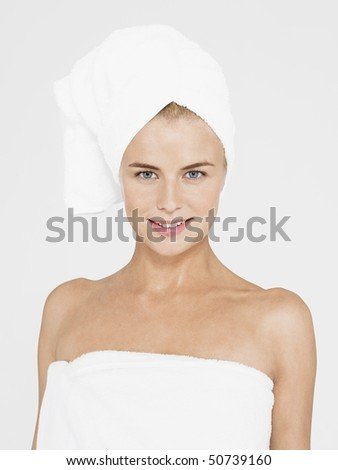 Young Woman with body and head Wrapped in Towels, portrait