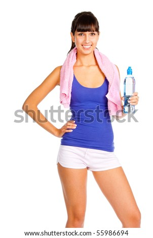 Young woman with bottle in the hand after fitness. Isolated over white.