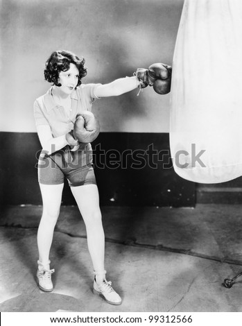 young woman with boxing gloves...
