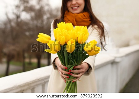 young woman with bright bouquet ...