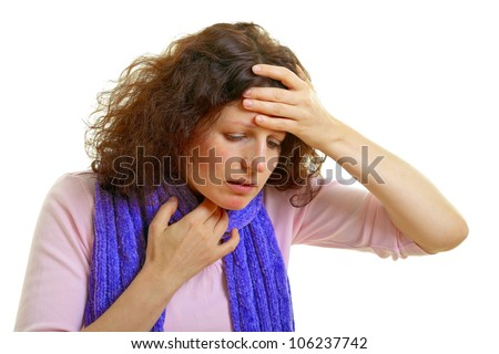 Young woman with brown hair has a flu and headache, isolated on white background, studio shot.