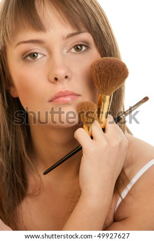 Young woman with brushes