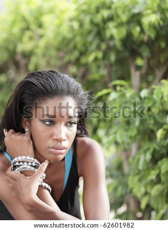 Young woman with bushes in the background
