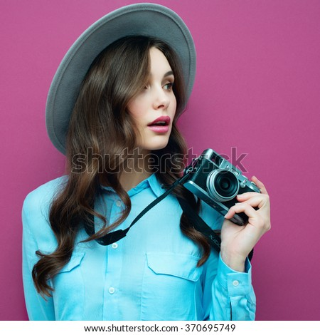 young woman with camera....