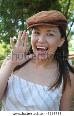 Young woman with cap shouting out loud