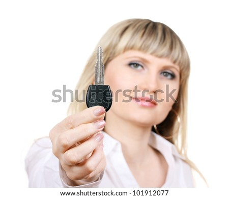 Young woman with car keys isolated on white