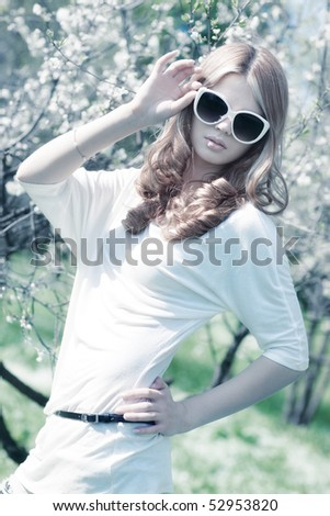 Young woman with cherry flowers. Birght white colors.
