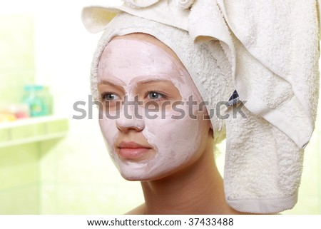 Young woman with clay mask