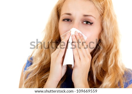 ... with cold sneezing into tissue over white background - stock photo