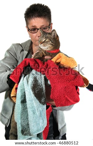 young woman with colorful clothes and a cat in her arms - stock photo