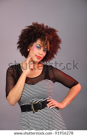 young woman with colourful make up thinking Color gels used