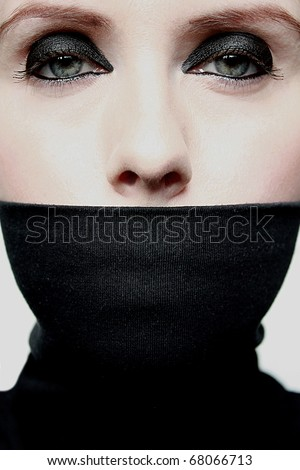 Young woman with covered mouth