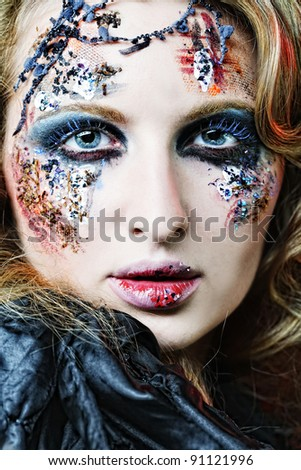 Young woman with creative make up. Halloween theme.