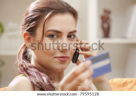 young woman with credit card and mobile phone