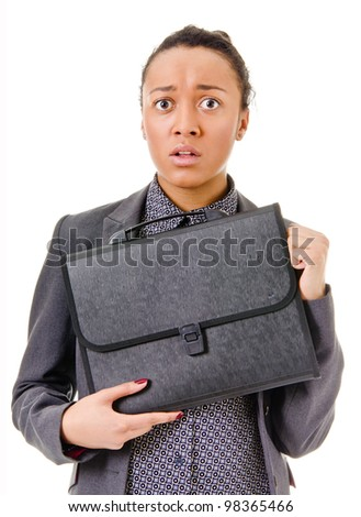 young woman with dark skin in a business suit afraid