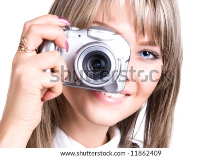 Young woman with digital camera. Isolated on white.