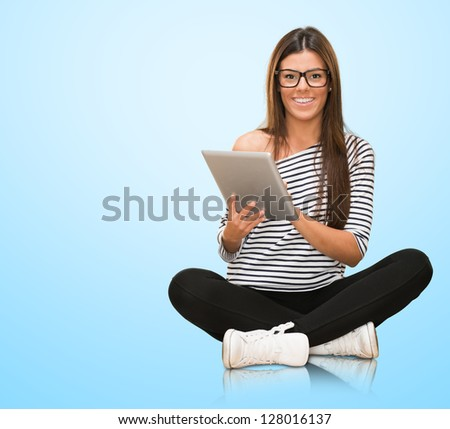 Young Woman With Digital Tablet Isolated On Blue Background