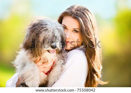 young woman with dog outdoor day portrait