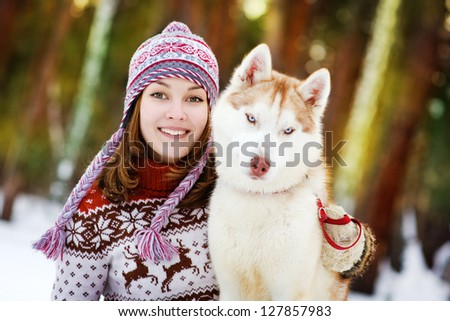Young woman with dog winter outdoors fun