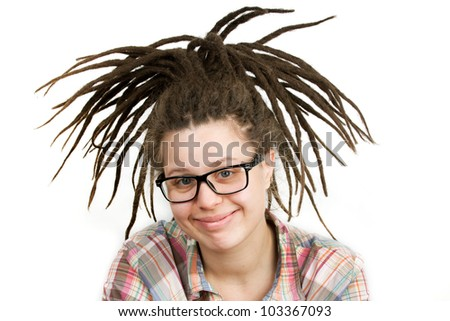 Young woman with dreadlocks wearing glasses and a shirt