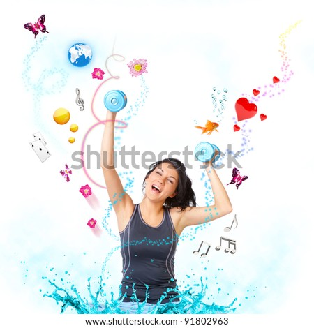 Young woman with dumbbells very happy with objects like butterflies, gold fish and other - stock photo