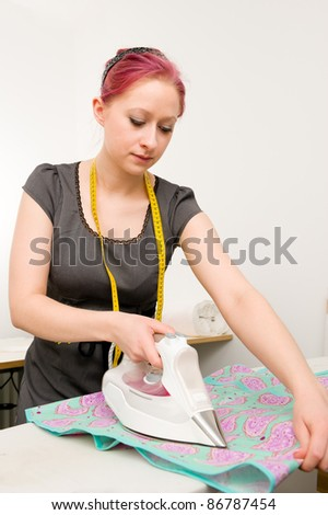 Young woman with electric iron