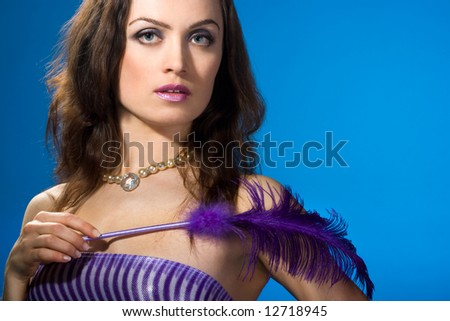young woman with feather on hands