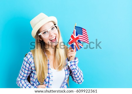 Young woman with flags of English speaking countries