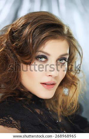 Young woman with fluffy hair.
