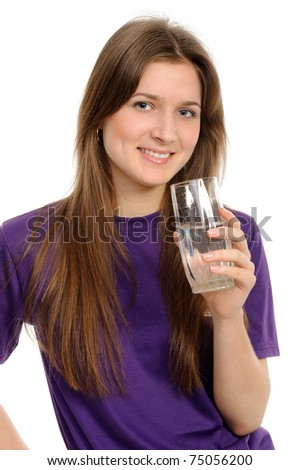 Young woman with glass of water isolated against white background - stock photo