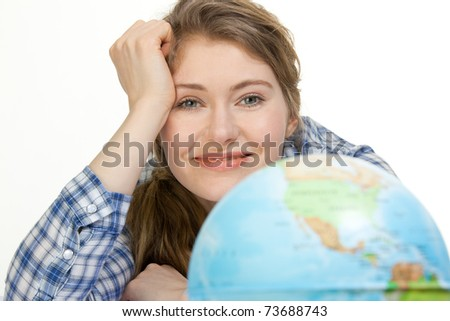 young woman with globe dreaming about traveling - stock photo