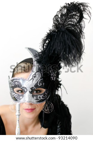 Young woman with gray and black masquerade mask