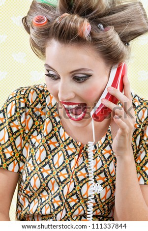 Young woman with hair curlers screaming out while holding a telephone