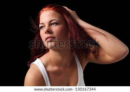 Young woman with hand in hair in front of a wind machine #130167344