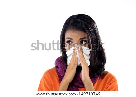 Young woman with handkerchief having cold. Isolated over white background